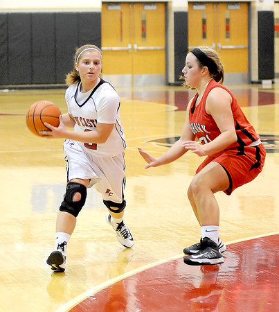 Courtney Caughey-Stambul/NEWS<br /> New Castle's Rachael Razzano looks to pass as Mohawk's Lucia Fee defends.