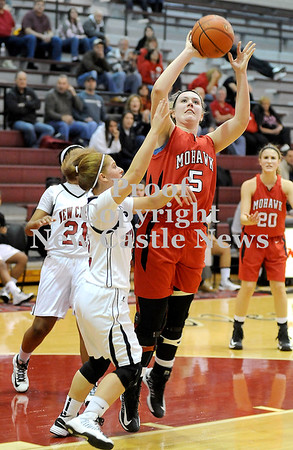 Courtney Caughey-Stambul/NEWS<br /> Mohawk's Katie Hoover shoots the basketball over New Castle's Rachael Razzano.