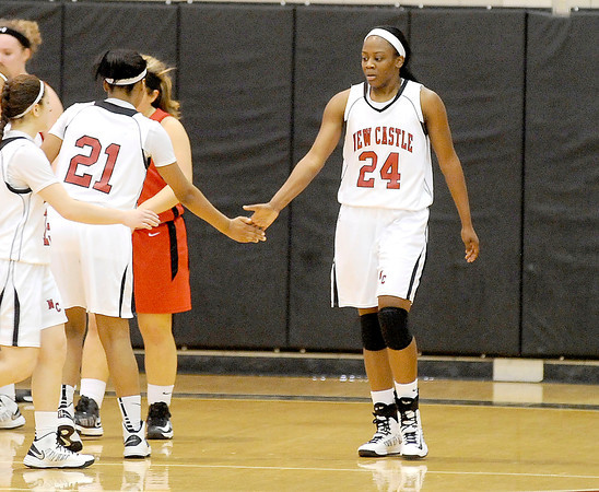 Courtney Caughey-Stambul/NEWS<br /> New Castle's Kelsey Scott, right, slap hands with teammates, Velvet Wade (21) and Dana Perrotta last night after scoring a layup and drawing a foul on the play.