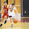 Courtney Caughey-Stambul/NEWS<br /> New Castle's Dana Perrotta and Mohawk's Hannah Morrow race to recover a loose ball last night.