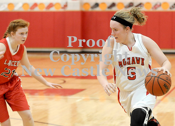 Courtney Caughey-Stambul/NEWS<br /> Mohawk's Katie Hoover drives to the basket as Neshannock's Erin Warvell defends.