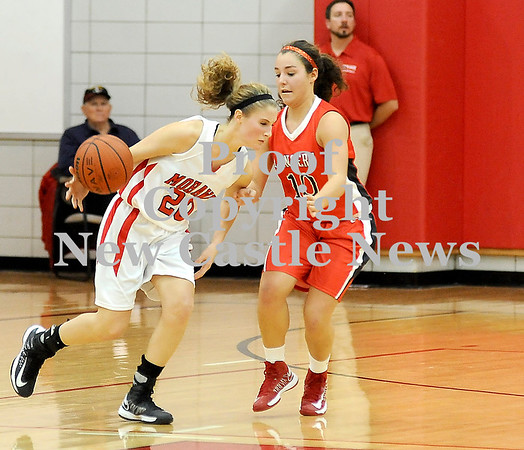 Courtney Caughey-Stambul/NEWS<br /> Mohawk's Shelby Brown looks to make a move around Neshannock's Katie Burrelli.