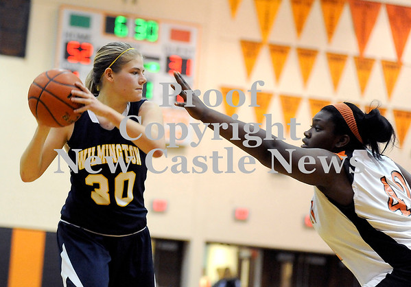 Courtney Caughey-Stambul/NEWS<br /> Wilmington's Sarah Slonaker protects the basketball from Sharon's Tanayja Sanders.