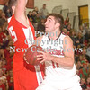 Erica Galvin/NEWS<br /> Mohawk's Vince Menichino takes the ball to the hoop against Neshannock's Tyler Haswell.