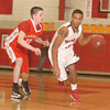 Erica Galvin/NEWS<br /> Mohawk's Saivon Watt dribbles down the court as Neshannock's Ethan Moose defends.