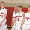 Erica Galvin/NEWS<br /> Mohawk teammates from left, Jonathan Grim, Ryan Sager, Vince Menichino and Boyd Laughner share a laugh as they watch their teammate Lucas Grim shoot free throws at the end of the game.