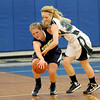 Courtney Caughey-Stambul/NEWS<br /> Wilmington's Sarah Slonaker fights to maintain possession of the basketball against Laurel's Callie Ritchie.