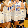 Courtney Caughey-Stambul/NEWS<br /> Union's Miranda Heaney, left, reaches out to hug teammate, Hannah Booth, after Booth's winning basket against Moniteau. Union's Tayshia Razo, center, also celebrates.