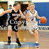 Courtney Caughey-Stambul/NEWS<br /> Union's Miranda Heaney brings the ball up the floor under pressure.
