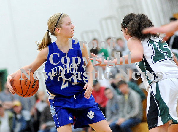 Courtney Caughey-Stambul/NEWS<br /> Union's Marissa Heaney looks to pass the basketball as Laurel's Brooke Dicks defends.