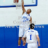Courtney Caughey-Stambul/NEWS<br /> Union's Tre Major dunks the basketball against Shenango.