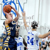 Courtney Caughey-Stambul/NEWS<br /> Shenango's Brenton Booher shoots the basketball over Union's Markel Peace.