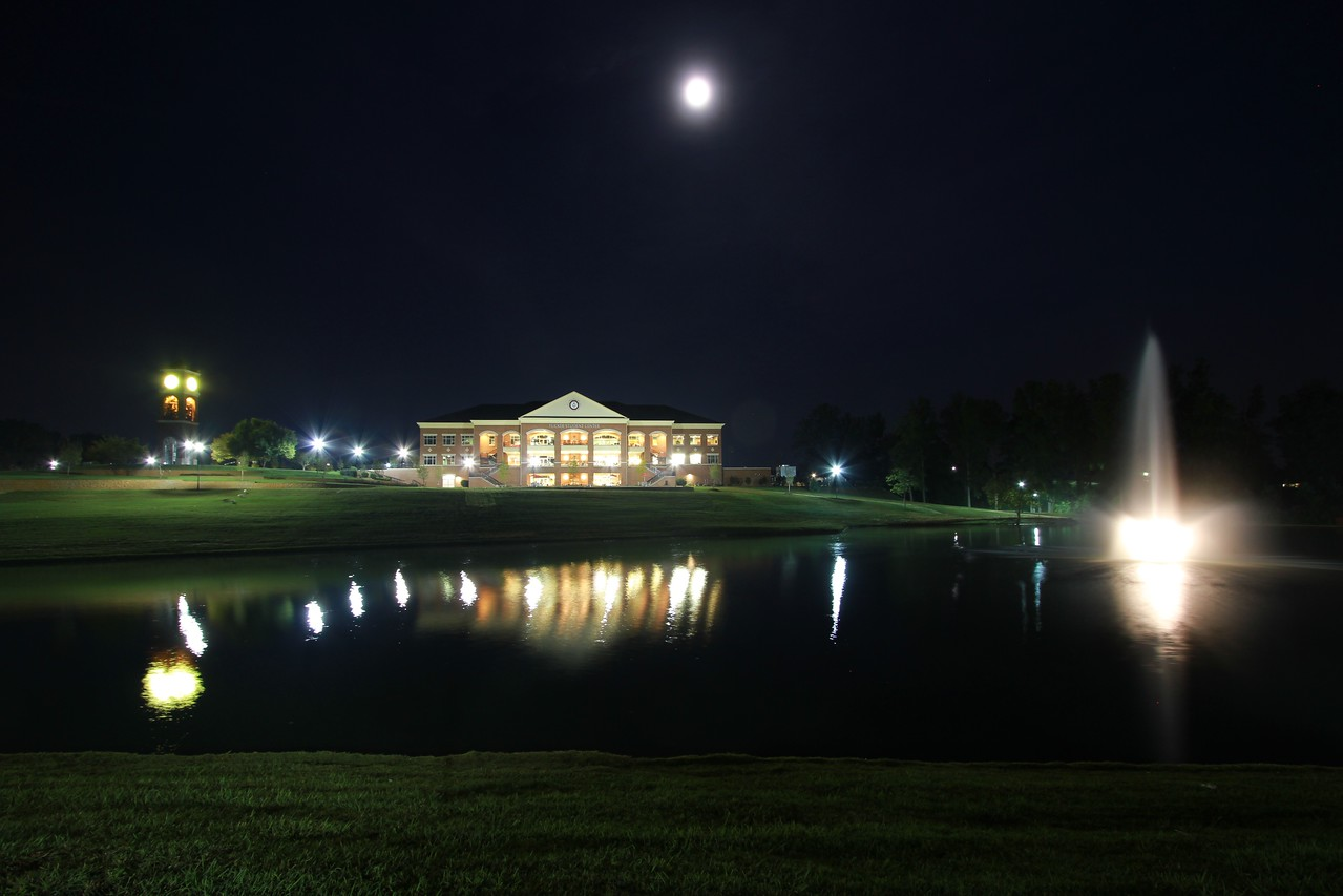 View of the Tucker Student Center from across Lake Hollifield.