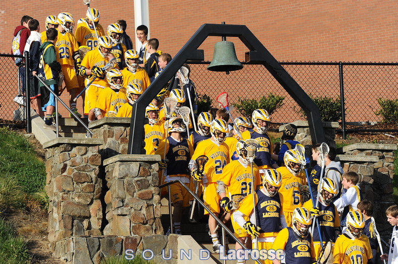 Traditional Entry under the bell by the Wolverine Varsity