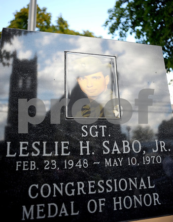 Courtney Caughey-Stambul/NEWS<br /> Ellwood City's Christ Presbyterian Church is reflected in the monument dedicated to Specialist Four Leslie H. Sabo, Jr.