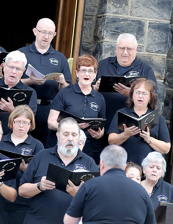 Courtney Caughey-Stambul/NEWS<br /> Members of the Ellwood Area Civic Chorale sing on Sunday.