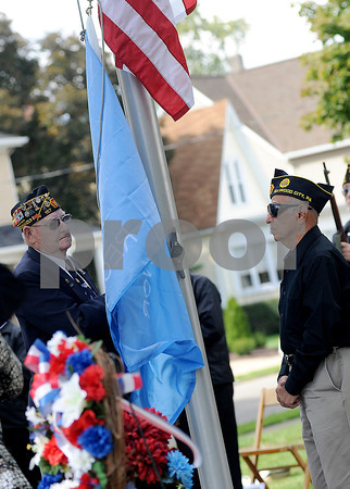 Courtney Caughey-Stambul/NEWS<br /> The Medal of Honor Flag is raised on Sunday.