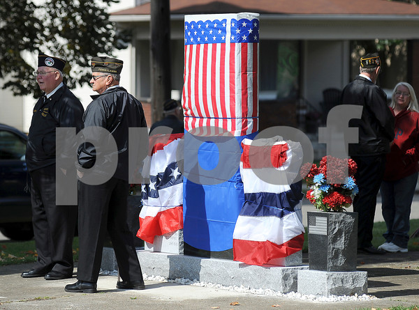 Courtney Caughey-Stambul/NEWS<br /> The monument dedicated to Medal of Honor recipient, Specialist Four Leslie H. Sabo, Jr., is covered prior to its public unveiling on Sunday.