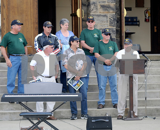 Courtney Caughey-Stambul/NEWS<br /> Sabo's Commander, Captain James Waybright, Company Commander of Bravo Co., 3rd Battalion, 506 Infantry, 101st Airborne Division, speaks on Sunday. To his right are fellow veterans of Bravo Co.