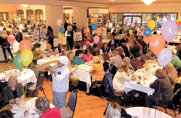 Dan Irwin/NEWS<br /> A record crowd of 360 people enjoys the ninth annual Taste of the Town last night at the New Englander Banquet Center. The event is a fundraiser for the United Way of Lawrence County.