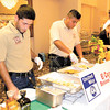 Dan Irwin/NEWS<br /> Juan Banales, left, and Williams Cruz of El Canelo serve up some of the Mexican restaurant's favorites last night at the Taste of the Town.