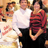 Dan Irwin/NEWS<br /> Taste of the Town chairwoman Joanne Preston takes time out from circulating around the New England Banquet Center to spend a few moments with Phil Gallo, owner of Gallo's Italian Villa.