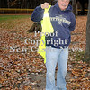 Courtney Caughey-Stambul/NEWS<br /> Dominick Motto puts on a safety vest before collecting litter at Gaston Park.