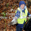 Courtney Caughey-Stambul/NEWS<br /> Mary Ann Pappalard dumps the contents of a bottle found lying in Gaston Park before throwing it away on Saturday.