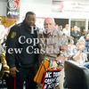 Scott R. Galvin / NEWS<br /> New Castle school security guard Darrell Holmes, left, escorts Russ Hall out of the New Castle Area School District board meeting yesterday.  Hall had made repeated outbursts disrupting the school board meeting.