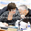 Scott R. Galvin / NEWS<br /> Barb Razzano, left, and Dr. Maryilyn Berkely discuss an item in the financial report for the Lockley Primary Center during the school board meeting for the New Castle Area School District yesterday.