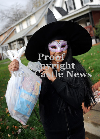Courtney Caughey-Stambul/NEWS<br /> Jordyn Berry, a student at George Washington, shows off the bag of candy she collected while trick-or-treating in New Castle on Saturday.