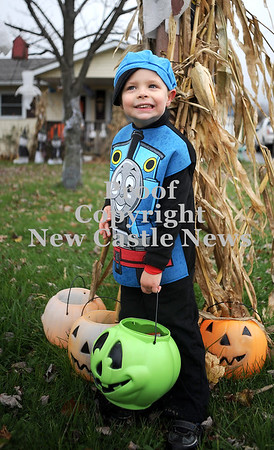 Courtney Caughey-Stambul/NEWS<br /> Austin Bloom, 4, dressed as Thomas the Tank Engine, smiles while trick-or-treating on Saturday in Union Township.