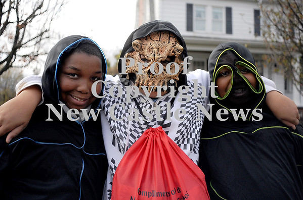 Courtney Caughey-Stambul/NEWS<br /> Jordan Reed-Williams, left, Braden Bailey, center, and Jayden Reed-Williams, right, trick-or-treat on Saturday in New Castle.
