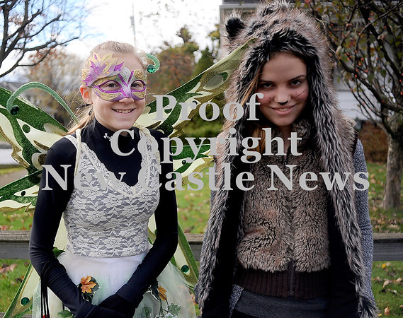 Courtney Caughey-Stambul/NEWS<br /> Neshannock students, Amelia Magusiak, left, and Sarah Duffy smile for a photo while trick-or-treating on Saturday.