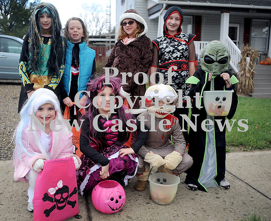 Courtney Caughey-Stambul/NEWS<br /> Trick-or-treaters collect candy in Bessemer on Saturday.