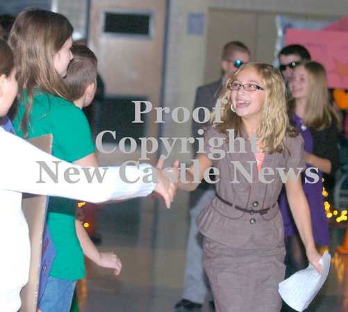 Erica Galvin/NEWS<br /> Hartman elementary student and candidate for school president, Madeline Spadafore greets fellow students before the mock debate yesterday.