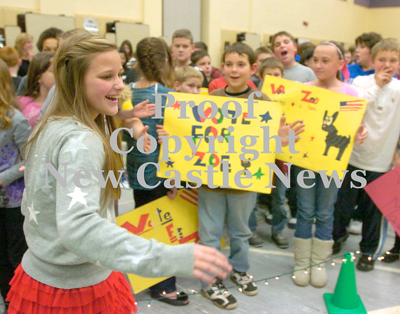 Erica Galvin/NEWS<br /> Hartman elementary student and candidate for school president, Zoe Maine greets other students after the mock debate yesterday.
