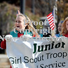 Courtney Caughey-Stambul/NEWS<br /> Girl Scouts in Laurel Troop 385 smile while walking in Saturday's Veterans Day parade.