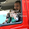 Courtney Caughey-Stambul/NEWS<br /> A youngster waves to the crowd while riding with members of the New Castle Fire Department in their truck on Saturday.