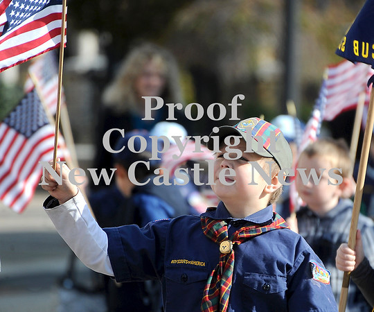 Courtney Caughey-Stambul/NEWS<br /> A member of Neshannock Cub Scout Pack 743 waves the American flag.