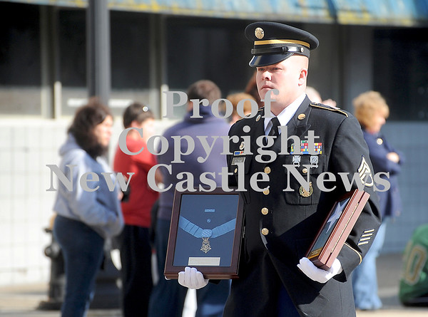Courtney Caughey-Stambul/NEWS<br /> A veteran proudly carries the Medal of Honor awarded to Spc. Leslie H. Sabo Jr.