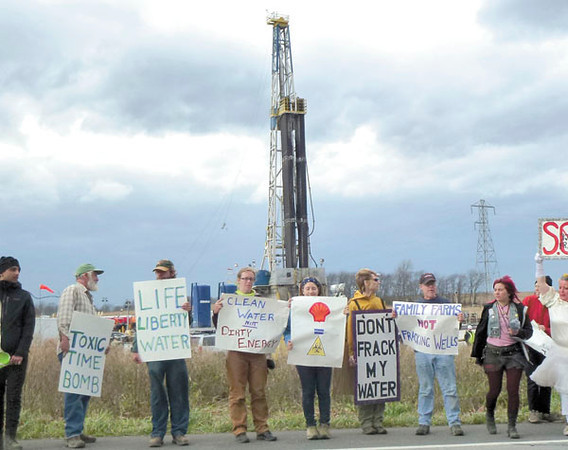 A line of pickets forms along Route 551 in North Beaver Township, protesting the drilling of a shale well by Shell Appalacia.