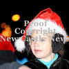 Courtney Caughey-Stambul/NEWS<br /> A member of CZ Gymnastics rides on the group's float, sporting a Santa hat and earmuffs for the parade.