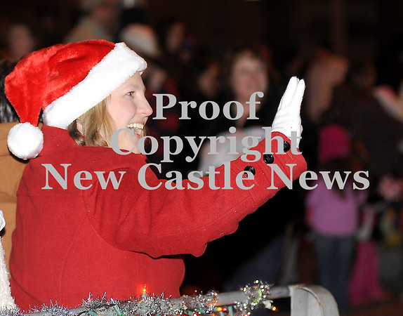 Courtney Caughey-Stambul/NEWS<br /> A passenger on the Parkstown Restaurant float waves to parade-goers.