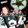 Courtney Caughey-Stambul/NEWS<br /> A student in the Laurel Spartan Marching Band plays a holiday-inspired tuba.