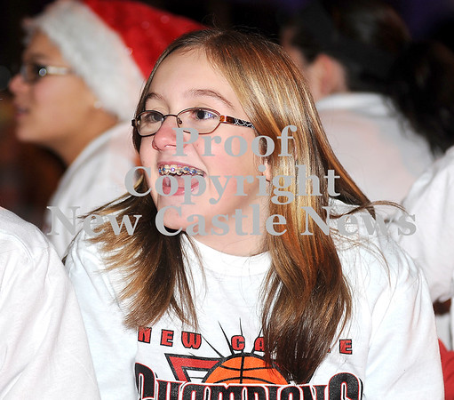 Courtney Caughey-Stambul/NEWS<br /> A New Castle student shares a laugh with friends while riding in last night's Light-Up Night parade.