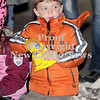 Courtney Caughey-Stambul/NEWS<br /> A young boy munches on a snack while watching the Light-Up Night parade.