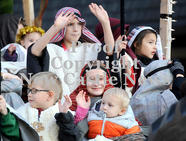 Courtney Caughey-Stambul/NEWS<br /> Children aboard the First Church of God float wave to parade-goers.