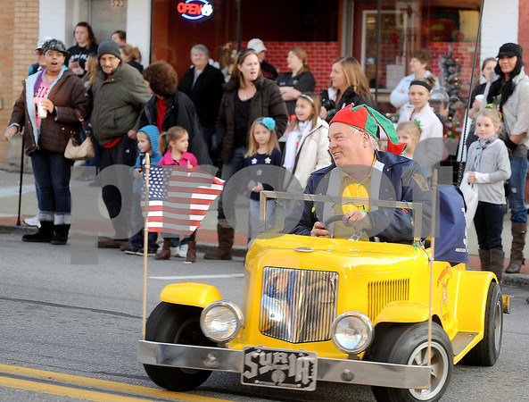 Courtney Caughey-Stambul/NEWS<br /> A member of the Shriners drives a mini-car in Saturday's parade.