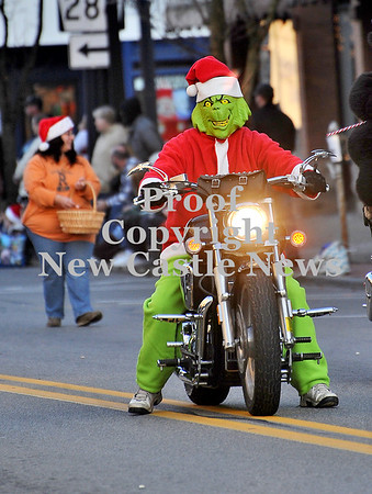 Courtney Caughey-Stambul/NEWS<br /> The Grinch rides a motorcycle at Ellwood City's Home for the Holidays parade on Saturday.